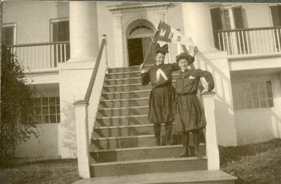Bessie Heard with another woman on the steps to a large building