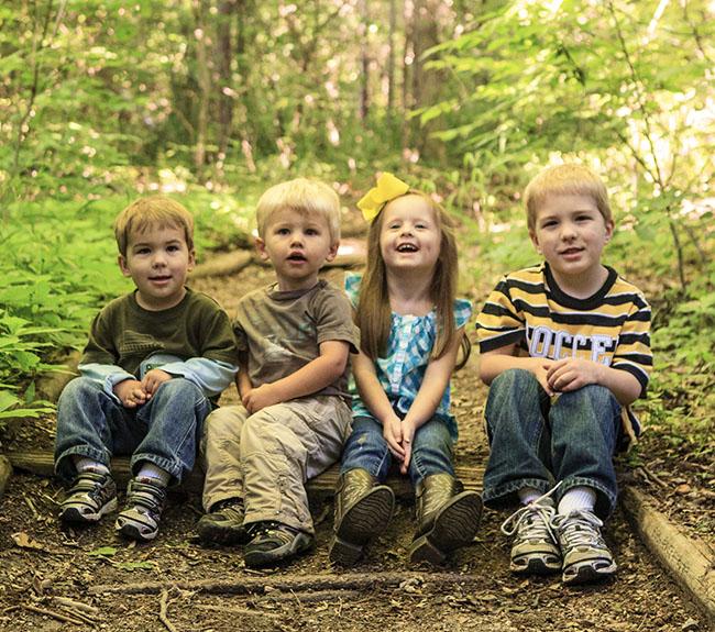 Children sitting on trail