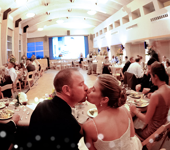 wedding celebration in the science resource center, bride and groom kissing
